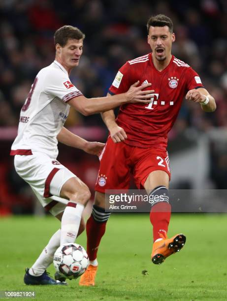 Sandro Wagner of Bayern Munich is challenged by Patrick Erras of Nuernberg during the Bundesliga match between FC Bayern Muenchen and 1 FC Nuernberg...