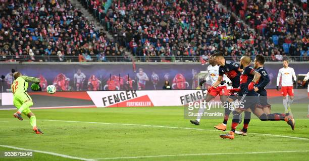 Sandro Wagner of Bayern scores the first goal during the Bundesliga match between RB Leipzig and FC Bayern Muenchen at Red Bull Arena on March 18...
