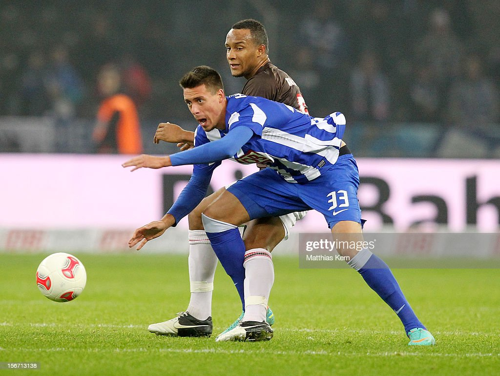 Sandro Wagner (L) of Berlin battles for the ball with Christopher Avevor (R) of St. Pauli during the Second Bundesliga match between Hertha BSC Berlin and FC St. Pauli at Olympic stadium on November 19, 2012 in Berlin, Germany.