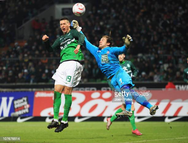 Sandro Wagner of Bremen and Tobias Sippel of Kaiserslautern battle for the ball during the Bundesliga match between SV Werder Bremen and 1 FC...
