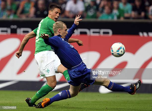 Sandro Wagner of Bremen and Tony Hibbert of Everton battle for the ball during the pre season friendly match between SV Werder Bremen and Everton at...