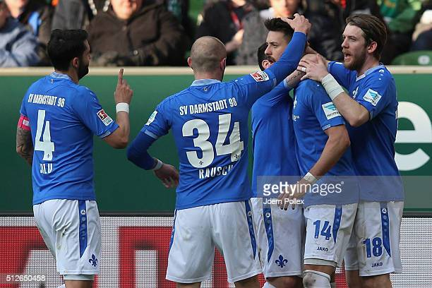 Sandro Wagner of Darmstadt celebrates with his team mates after scoring his team's first goal during the Bundesliga match between Werder Bremen and...