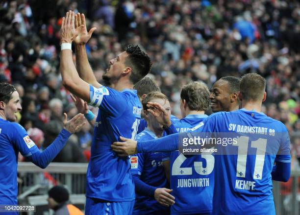 Sandro Wagner of Darmstadt celebrates with teammates after his goal at 10 during the German Bundesliga soccer match between Bayern Munich and...
