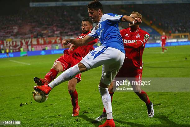 Sandro Wagner of Darmstadt is challenged by Dominic Maroh of Koeln during the Bundesliga match between SV Darmstadt 98 and 1 FC Koeln at MerckStadion...