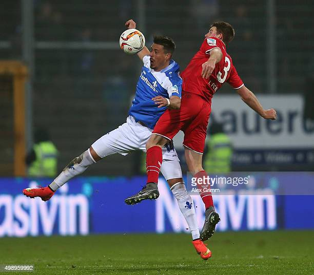Sandro Wagner of Darmstadt is challenged by Dominique Heintz of Koeln during the Bundesliga match between SV Darmstadt 98 and 1 FC Koeln at...