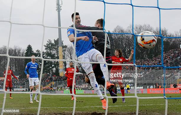 Sandro Wagner of Darmstadt scores his team's first goal past goalkeeper Bernd Leno of Leverkusen during the match between SV Darmstadt 98 and Bayer...
