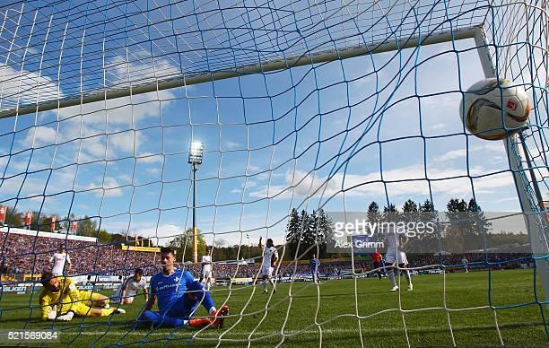 Sandro Wagner of Darmstadt scores his team's second goal against goalkeeper Ramazan Oezcan of Ingolstadt during the Bundesliga match between SV...
