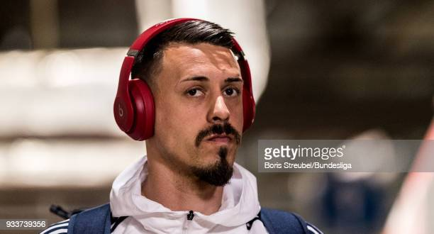 Sandro Wagner of FC Bayern Muenchen arrives with the bus prior to the Bundesliga match between RB Leipzig and FC Bayern Muenchen at Red Bull Arena on...