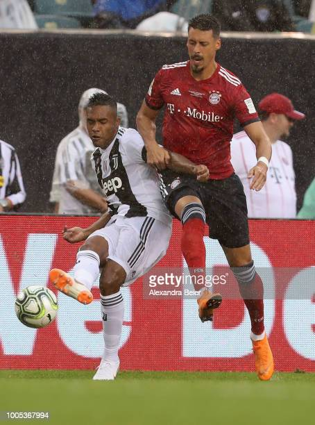 Sandro Wagner of FC Bayern Muenchen fights for the ball with Alex Sandro of Juventus Turin during the International Champions Cup match between...