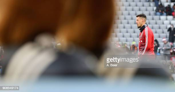 Sandro Wagner of FC Bayern Muenchen warms up behind the shoes of FC Bayern mascot Berni for the Bundesliga match between FC Bayern Muenchen and...