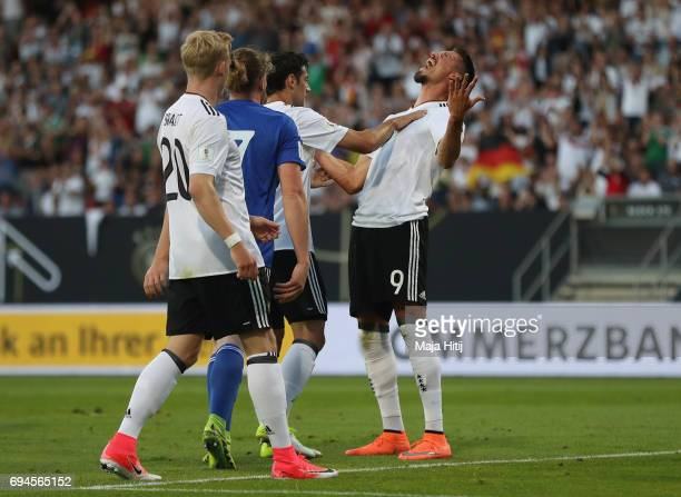 Sandro Wagner of Germany celebrates scoring his sides second goal with his Germany team mates during the FIFA 2018 World Cup Qualifier between...