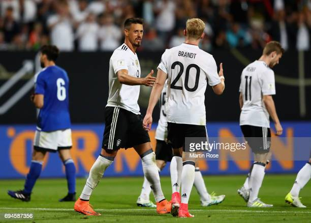 Sandro Wagner of Germany celebrates scoring his sides seventh goal with Julian Brandt of Germany during the FIFA 2018 World Cup Qualifier between...