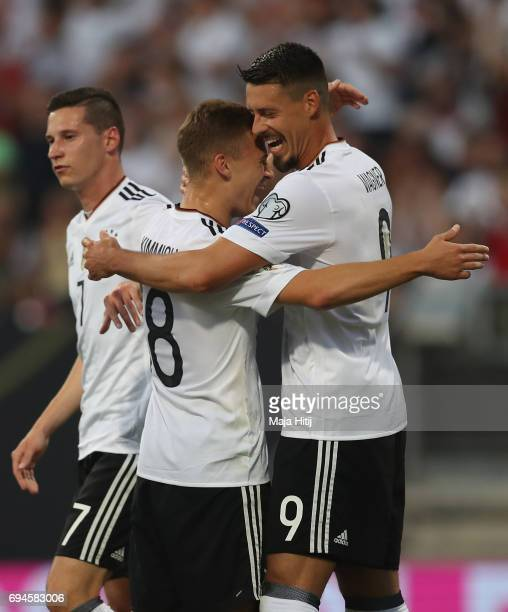 Sandro Wagner of Germany celebrates scoring his sides third goal with Leon Goretzka of Germany during the FIFA 2018 World Cup Qualifier between...