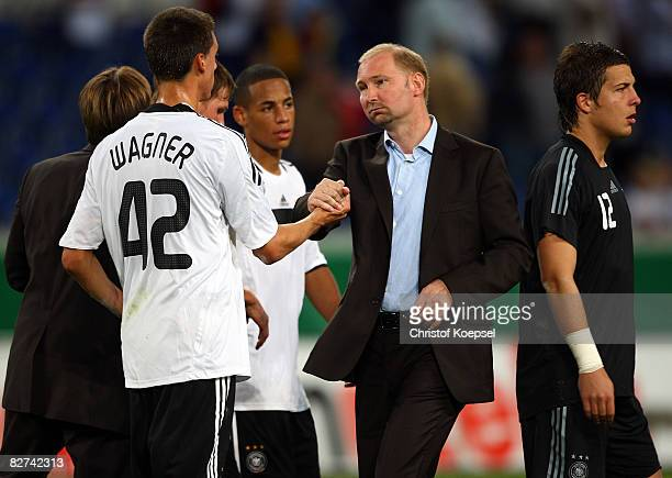 Sandro Wagner of Germany celebrates the 00 draw and the qualification to the Eruo 2009 with national coach Dieter Eilts after the UEFA Under21...