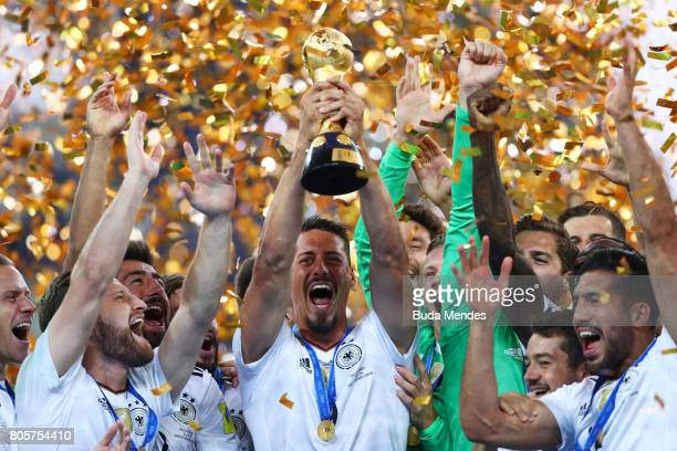 Sandro Wagner of Germany lifts the FIFA Confederations Cup trophy after the FIFA Confederations Cup Russia 2017 Final between Chile and Germany at...