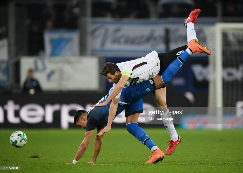 Sandro Wagner of Hoffenheim and David Abraham of Frankfurt compete for the ball during the Bundesliga match between TSG 1899 Hoffenheim and Eintracht Frankfurt at Wirsol Rhein-Neckar-Arena on November 18, 2017 in Sinsheim, Germany.
