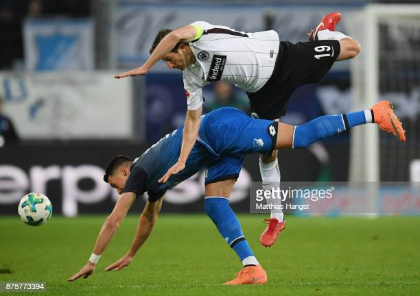Sandro Wagner of Hoffenheim and David Abraham of Frankfurt compete for the ball during the Bundesliga match between TSG 1899 Hoffenheim and Eintracht...