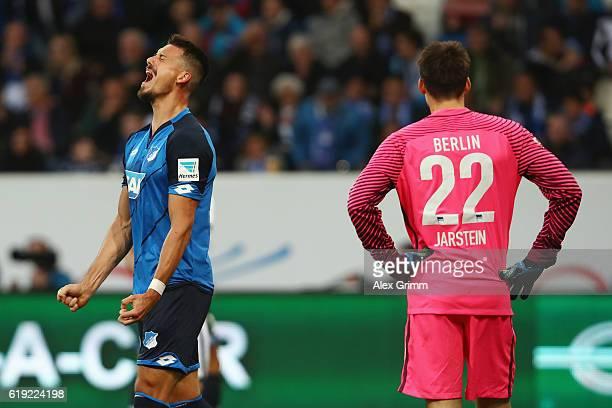Sandro Wagner of Hoffenheim and goalkeeper Rune Jarstein of Berlin reacts during the Bundesliga match between TSG 1899 Hoffenheim and Hertha BSC at...