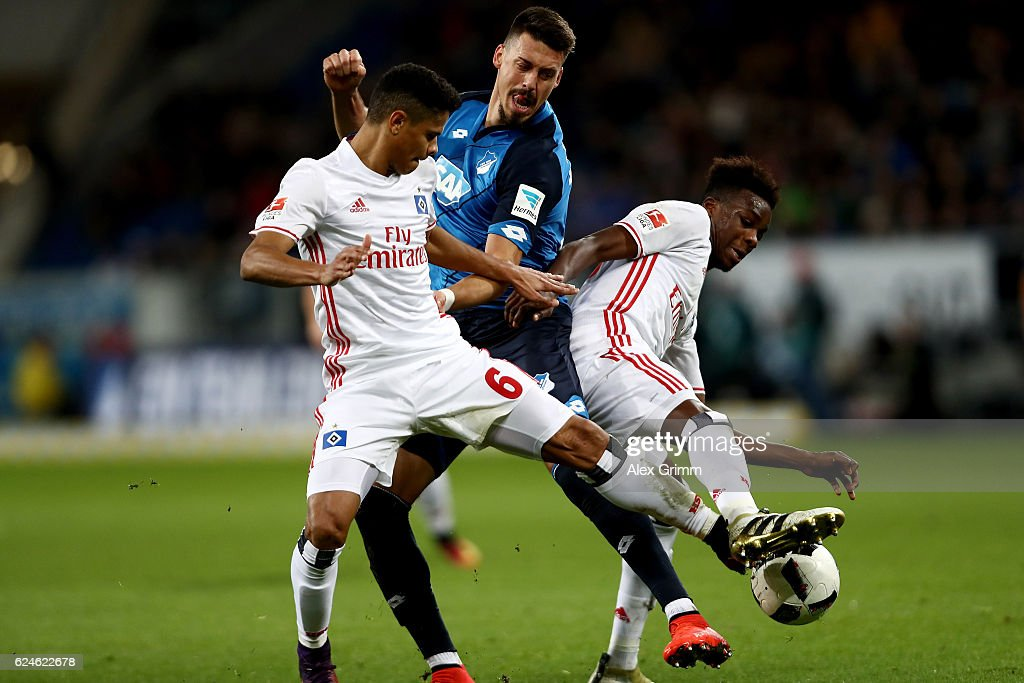 Sandro Wagner (C) of Hoffenheim and Justino Do Santos and Gideon Jung of Hamburg battle for the ball during the Bundesliga match between TSG 1899 Hoffenheim and Hamburger SV at Wirsol Rhein-Neckar-Arena on November 20, 2016 in Sinsheim, Germany.