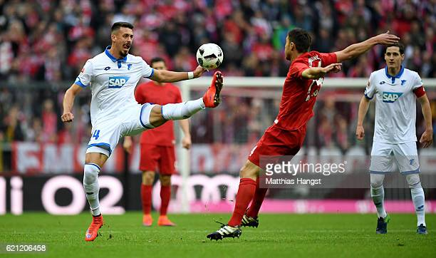 Sandro Wagner of Hoffenheim and Xabi Alonso of Muenchen compete for the ball during the Bundesliga match between Bayern Muenchen and TSG 1899...