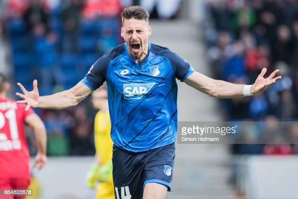 Sandro Wagner of Hoffenheim celebrates his team's first goal during the Bundesliga match between TSG 1899 Hoffenheim and Bayer 04 Leverkusen at...