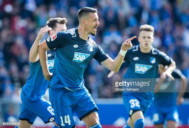 Sandro Wagner of Hoffenheim celebrates his team's first goal with team mate Havard Nordtveit during the Bundesliga match between TSG 1899 Hoffenheim...