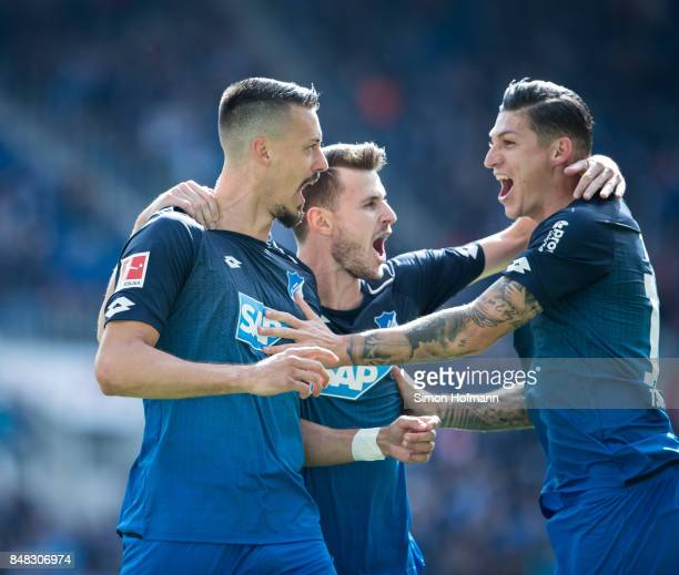 Sandro Wagner of Hoffenheim celebrates his team's first goal with team mates Havard Nordtveit and Steven Zuber during the Bundesliga match between...