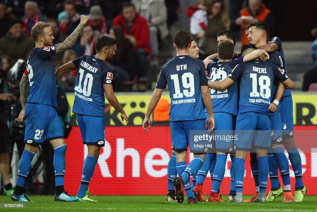 Sandro Wagner (R) of Hoffenheim celebrates his team's second goal with team mates during the Bundesliga match between 1. FC Koeln and TSG 1899 Hoffenheim at RheinEnergieStadion on November 5, 2017 in Cologne, Germany.