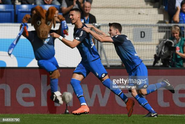 Sandro Wagner of Hoffenheim celebrates with his teammates after scoring his team's first during the Bundesliga match between TSG 1899 Hoffenheim and...