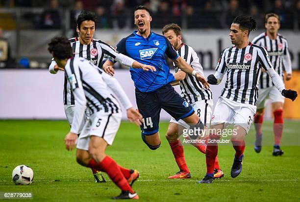 Sandro Wagner of Hoffenheim challenges Szabolcs Huszti of Frankfurt Omar Mascarell of Frankfurt Jesus Vallejo of Frankfurt during the Bundesliga...