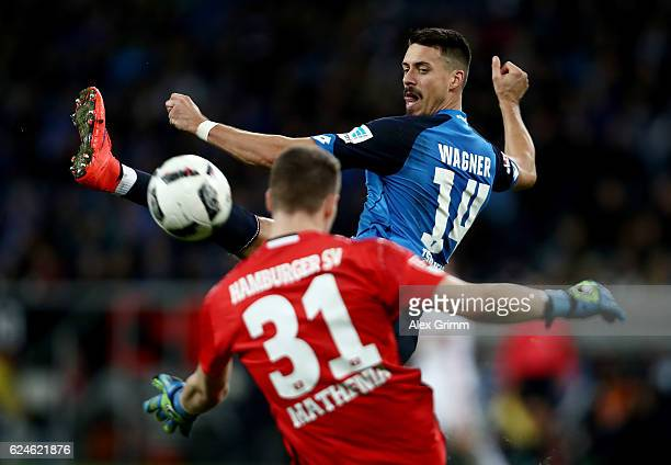 Sandro Wagner of Hoffenheim fails to score over Christian Mathenia goalkeeper of Hamburg during the Bundesliga match between TSG 1899 Hoffenheim and...