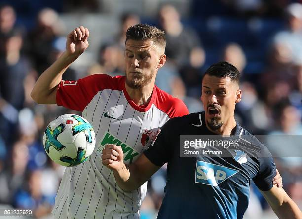 Sandro Wagner of Hoffenheim fights for the ball with Jeffrey Gouweleeuw of Augsburg during the Bundesliga match between TSG 1899 Hoffenheim and FC...