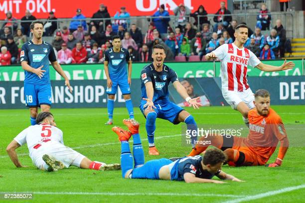 Sandro Wagner of Hoffenheim gestures and Dennis Geiger of Hoffenheim on the ground during the Bundesliga match between 1 FC Koeln and TSG 1899...