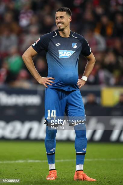 Sandro Wagner of Hoffenheim hides the ball under his jersey during the Bundesliga match between 1 FC Koeln and TSG 1899 Hoffenheim at...
