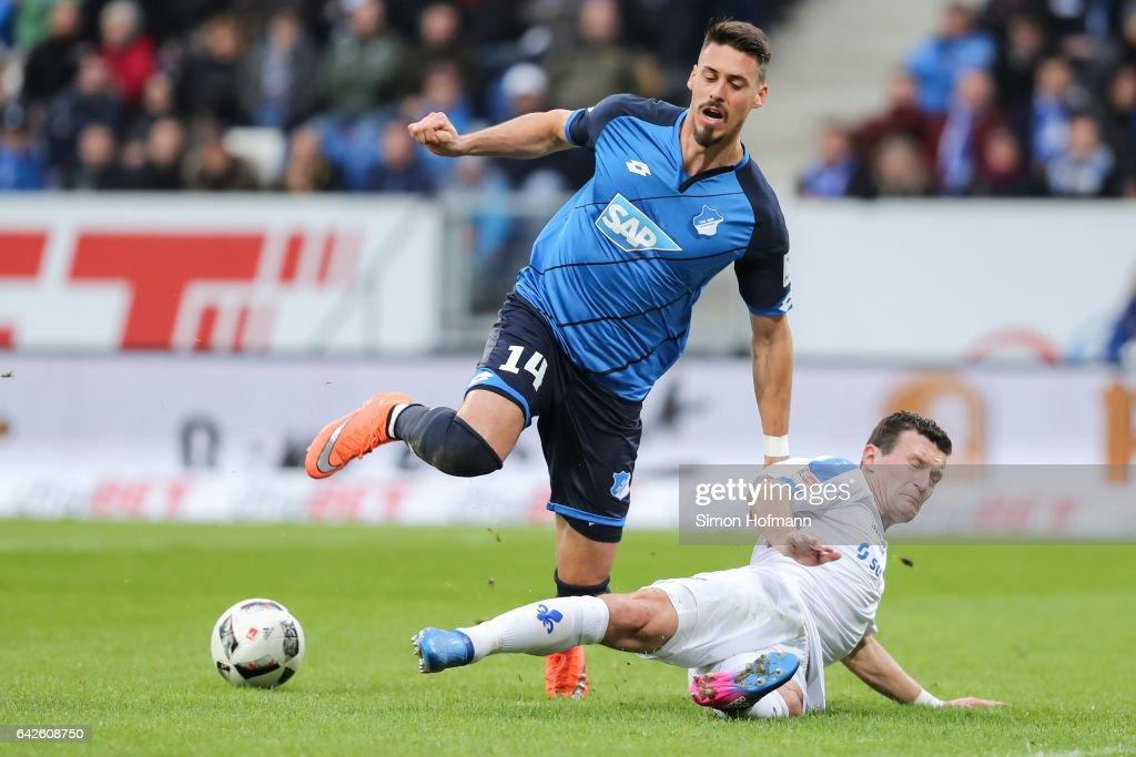 Sandro Wagner of Hoffenheim is challenged by Artem Fedetsky of Darmstadt during the Bundesliga match between TSG 1899 Hoffenheim and SV Darmstadt 98 at Wirsol Rhein-Neckar-Arena on February 18, 2017 in Sinsheim, Germany.