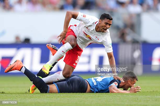 Sandro Wagner of Hoffenheim is challenged by Marvin Compper of Leipzig during the Bundesliga match between TSG 1899 Hoffenheim and RB Leipzig at...