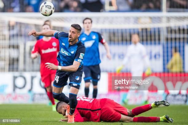 Sandro Wagner of Hoffenheim is challenged by Michael Hector of Frankfurt during the Bundesliga match between TSG 1899 Hoffenheim and Eintracht...