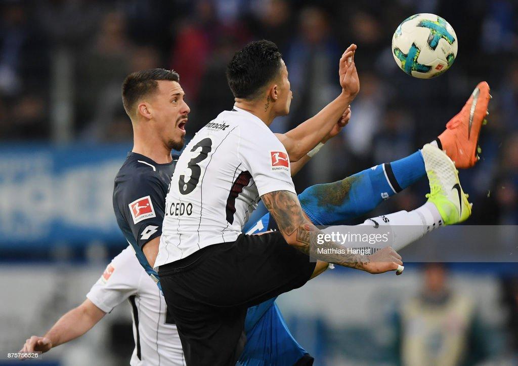 Sandro Wagner of Hoffenheim is challenged by Simon Falette of Frankfurt during the Bundesliga match between TSG 1899 Hoffenheim and Eintracht Frankfurt at Wirsol Rhein-Neckar-Arena on November 18, 2017 in Sinsheim, Germany.