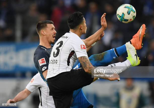 Sandro Wagner of Hoffenheim is challenged by Simon Falette of Frankfurt during the Bundesliga match between TSG 1899 Hoffenheim and Eintracht...