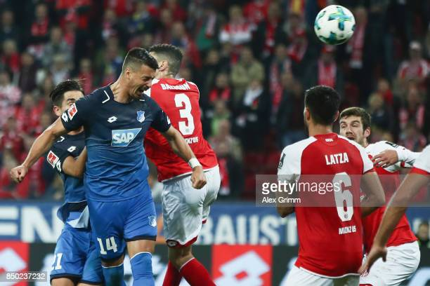 Sandro Wagner of Hoffenheim scores his team's second goal against Leon Balogun of Mainz during the Bundesliga match between 1 FSV Mainz 05 and TSG...