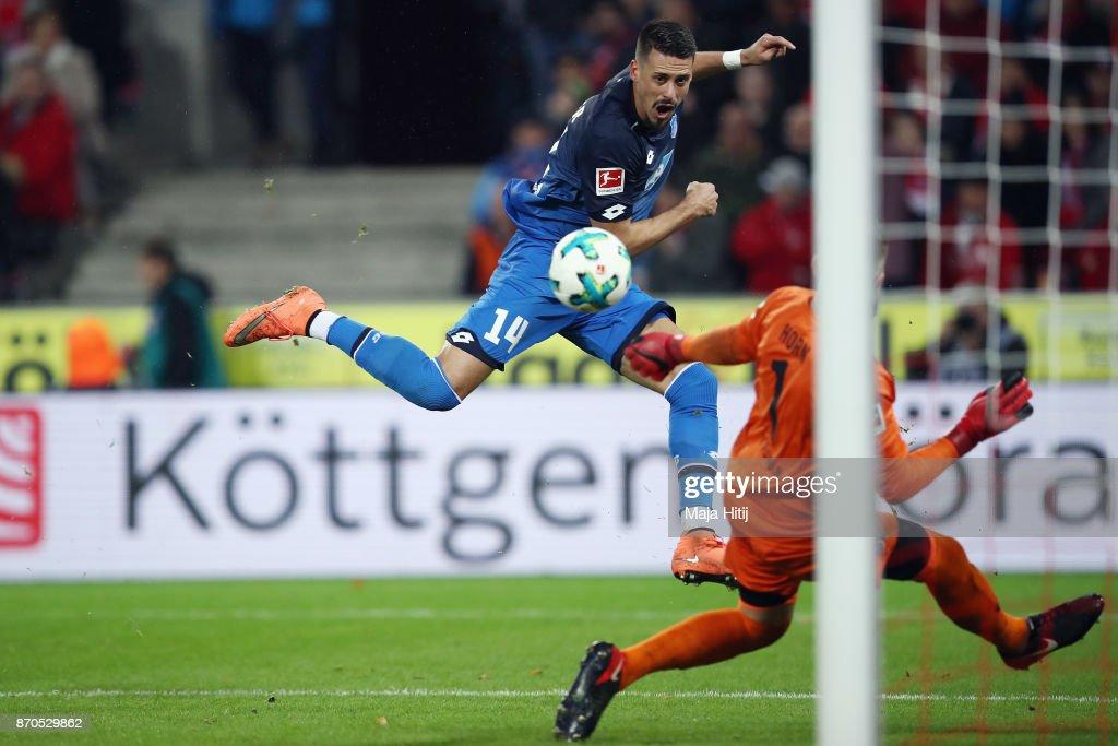 Sandro Wagner of Hoffenheim scores his team's third goal past goalkeeper Timo Horn of Koeln during the Bundesliga match between 1. FC Koeln and TSG 1899 Hoffenheim at RheinEnergieStadion on November 5, 2017 in Cologne, Germany.