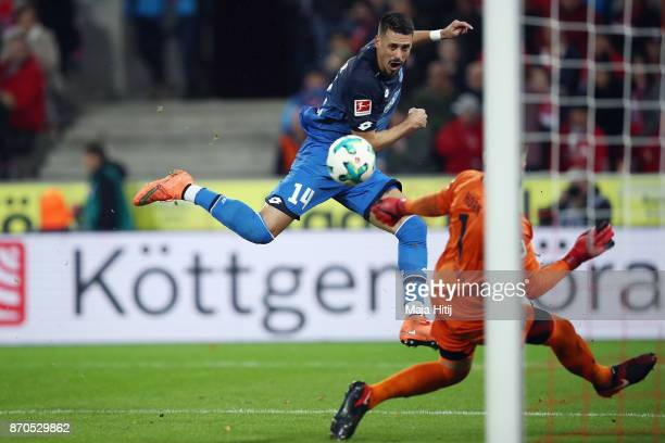 Sandro Wagner of Hoffenheim scores his team's third goal past goalkeeper Timo Horn of Koeln during the Bundesliga match between 1 FC Koeln and TSG...