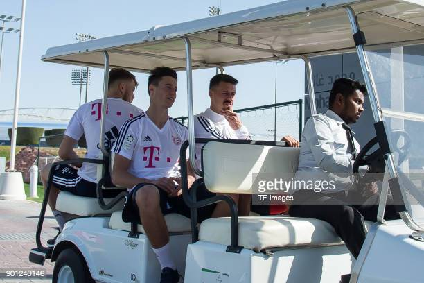 Sandro Wagner of Muenchen and Marco Friedl of Muenchen drive in a golf cart during the FC Bayern Muenchen training camp at Aspire Academy on January...