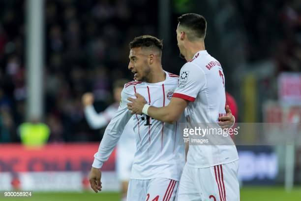 Sandro Wagner of Muenchen celebrates after scoring his team`s third goal with Corentin Tolisso of Muenchen during the Bundesliga match between...