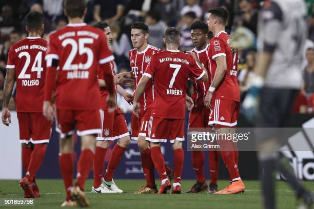 Sandro Wagner of Muenchen celebrates his team's first goal with team mates during the friendly match between AlAhli and Bayern Muenchen on day 5 of...