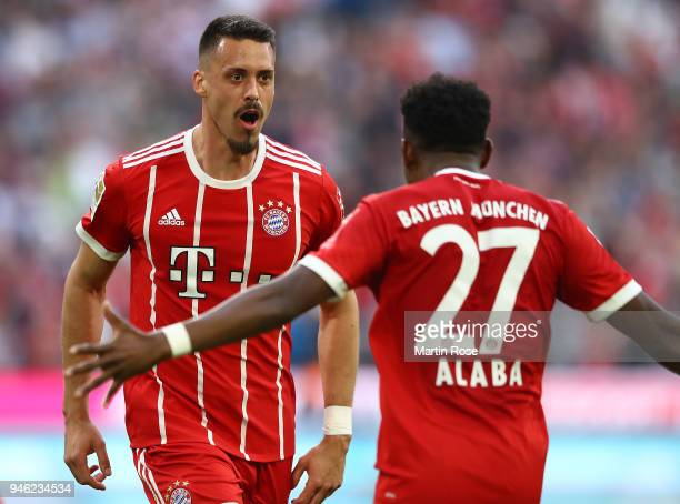 Sandro Wagner of Muenchen celebrates with David Alaba of Bayern Muenchen after he scored a goal to make it 21 during the Bundesliga match between FC...