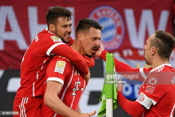 Sandro Wagner of Muenchen celebrates with Juan Bernat of Bayern Muenchen and Franck Ribery of Bayern Muenchen after he scored a goal to make it 11...