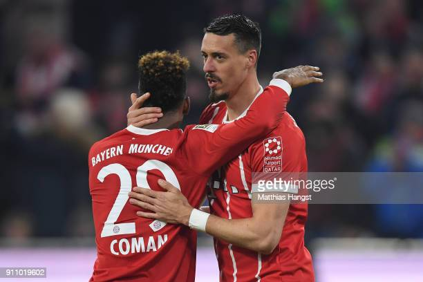 Sandro Wagner of Muenchen celebrates with Kingsley Coman of Bayern Muenchen after he scored a goal to make it 52 during the Bundesliga match between...