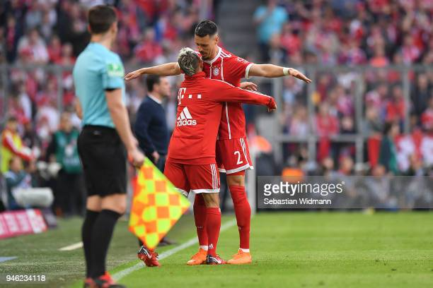 Sandro Wagner of Muenchen celebrates with Rafinha of Bayern Muenchen after he scored a goal to make it 11 during the Bundesliga match between FC...
