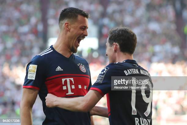 Sandro Wagner of Muenchen celebrates with Sebastian Rudy of Bayern Muenchen after he scored a goal to make it 14 during the Bundesliga match between...